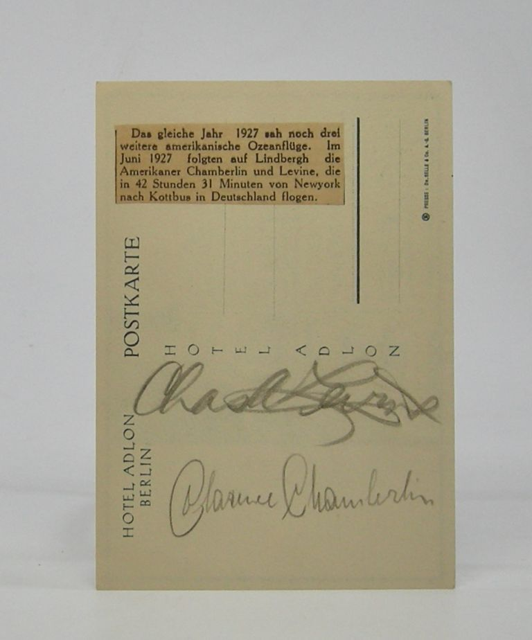 Pencilled autographs of the two aviators; both on the message side of a postcard from Berlin's Hotel Adlon. Clarence Chamberlin, Charles Levine.
